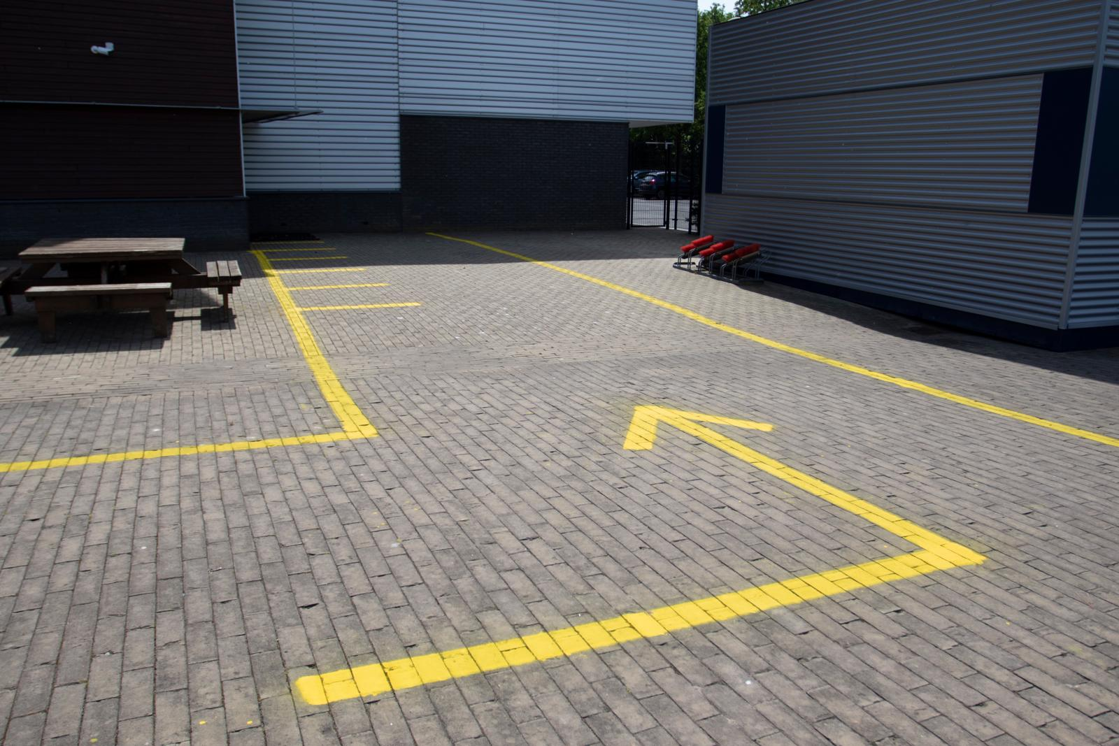 Direction arrows outside at The British School in the Netherlands