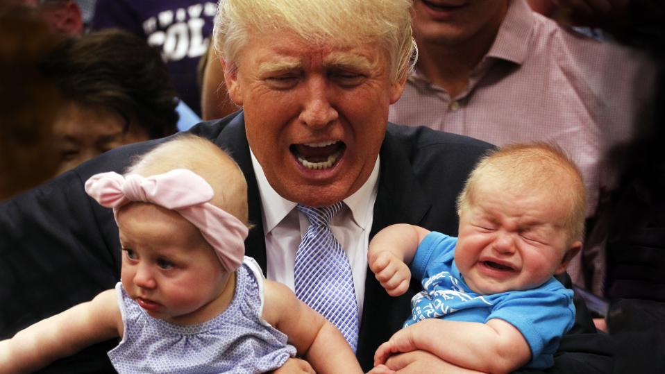 Donald Trump, holding a bawling baby in his arms, and appearing to bawl himself