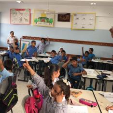 Saving the environment: Pupils around the world, including these in Palestine, have joined forces to help protect the world's rivers and oceans
