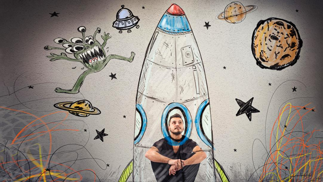 Man in a drawing of a rocket surrounded by stars, planets and aliens – deprived students college partnerships scholarships