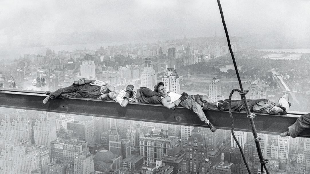 Black-and-white photo of construction workers taking a break in the air – teacher tiredness afternoon lull body clocks