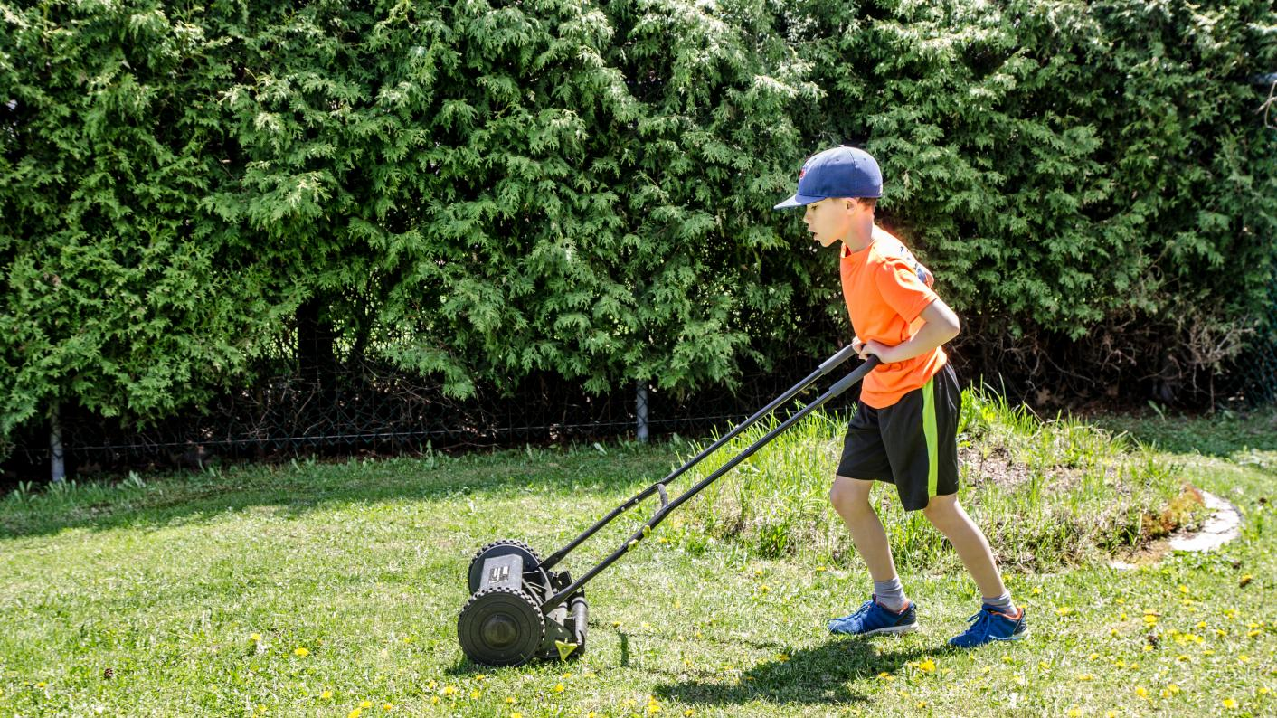 Child mowing the lawn