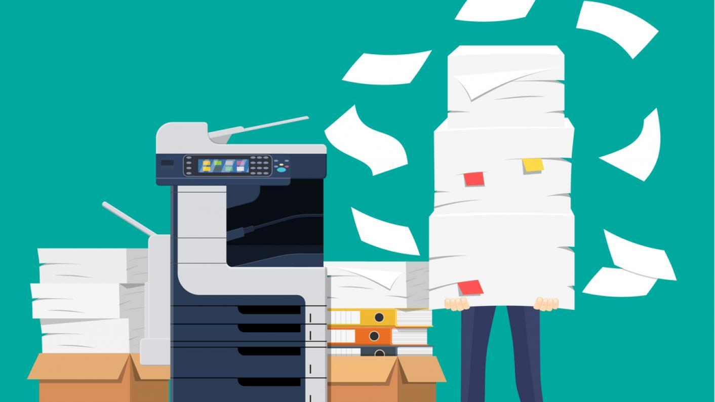 Cartoon of man standing by photocopier