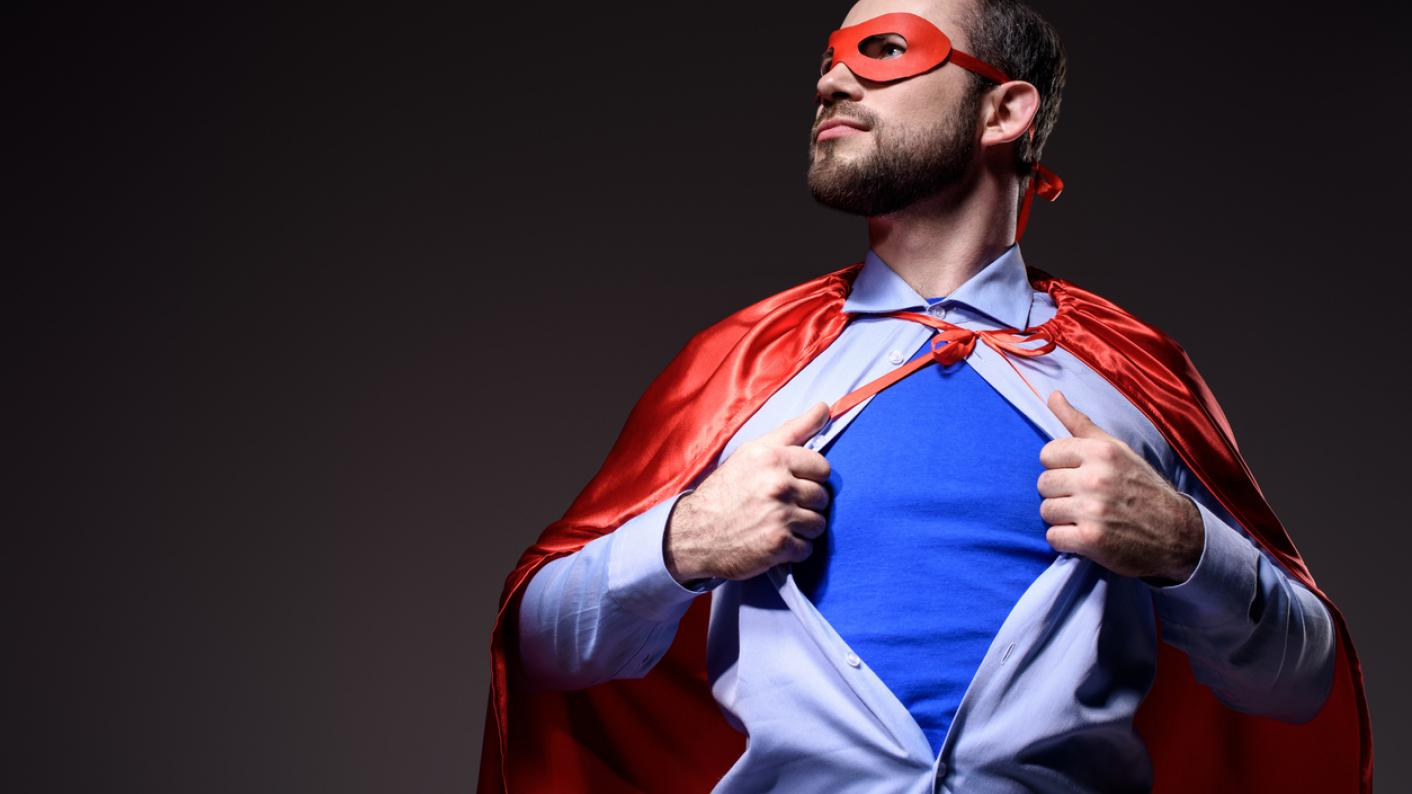 Man rips off shirt, to reveal superhero costume
