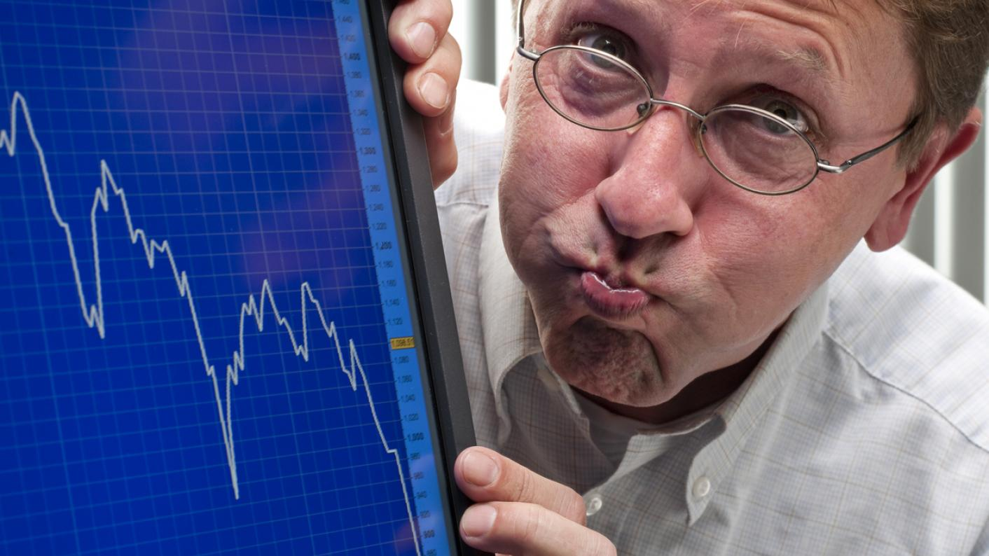 Man with graph showing plummeting readings