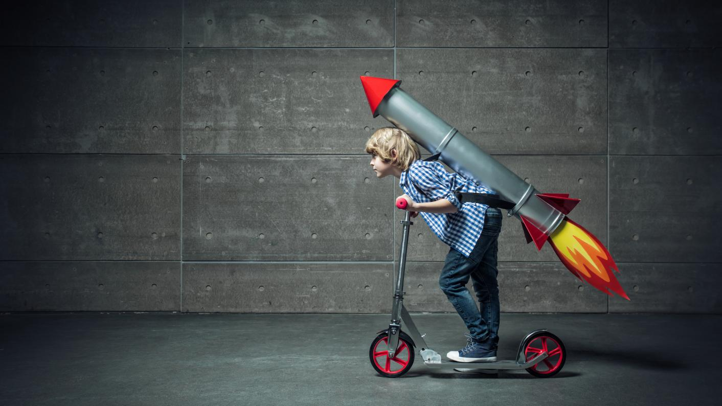 OFsted curriculum: boy on scooter with rocket on back