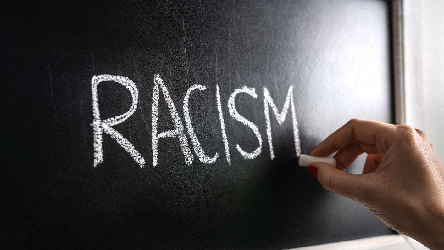 Racism in Scottish schools has been highlighted by a new report
