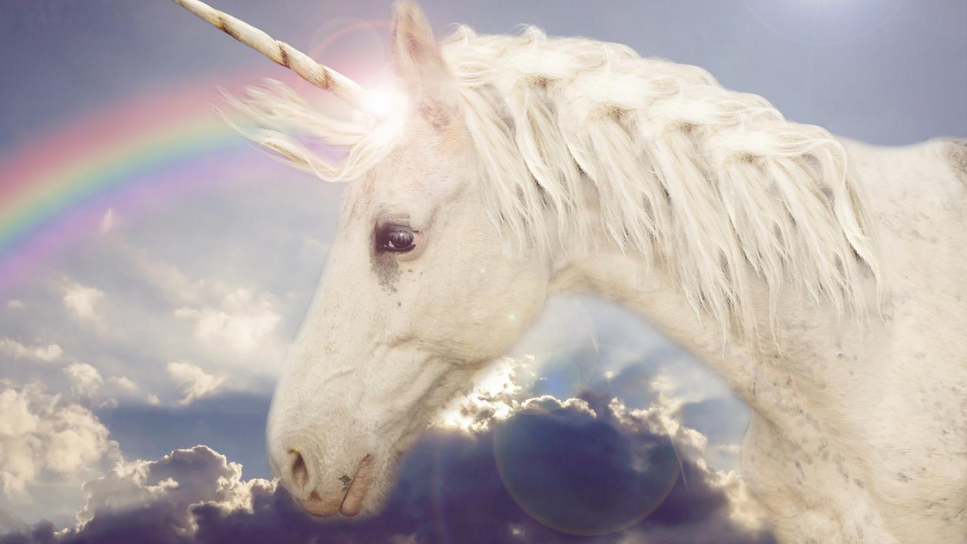 Unicorn, with rainbow in the background