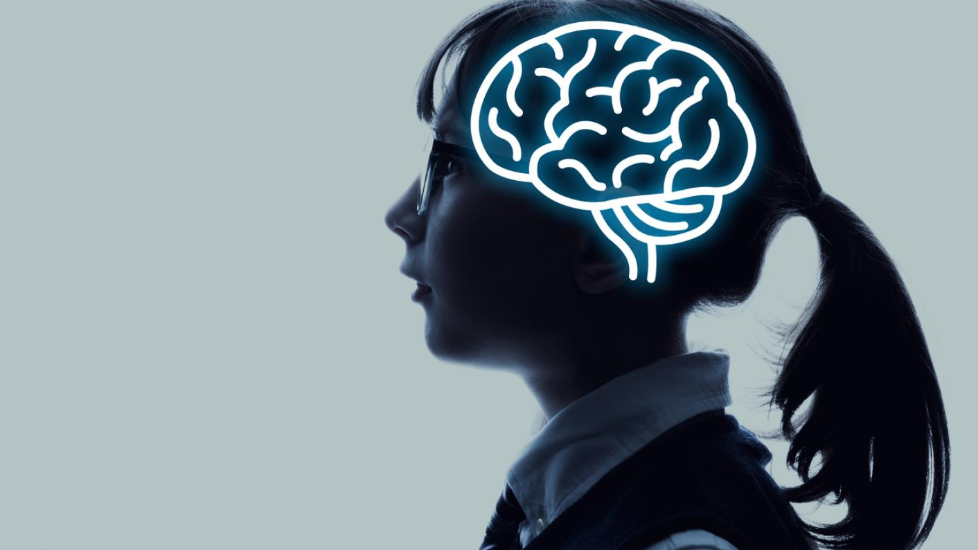 Profile of schoolgirl, with image of brain superimposed on her head