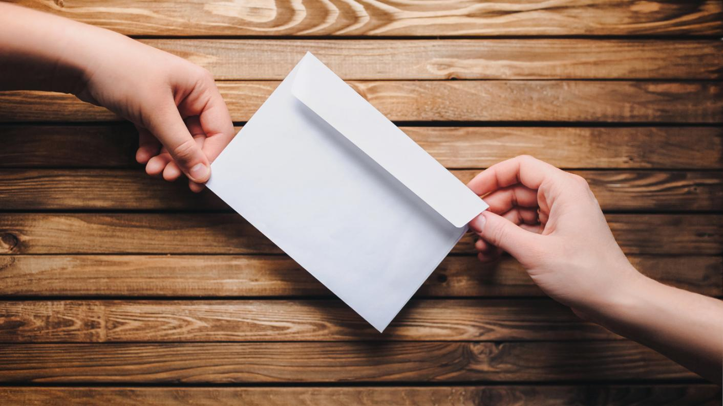 Letter being passed from one person to another