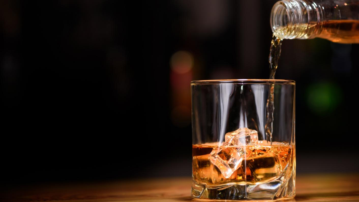 A teacher has avoided being banned from the profession after being found drunk at school