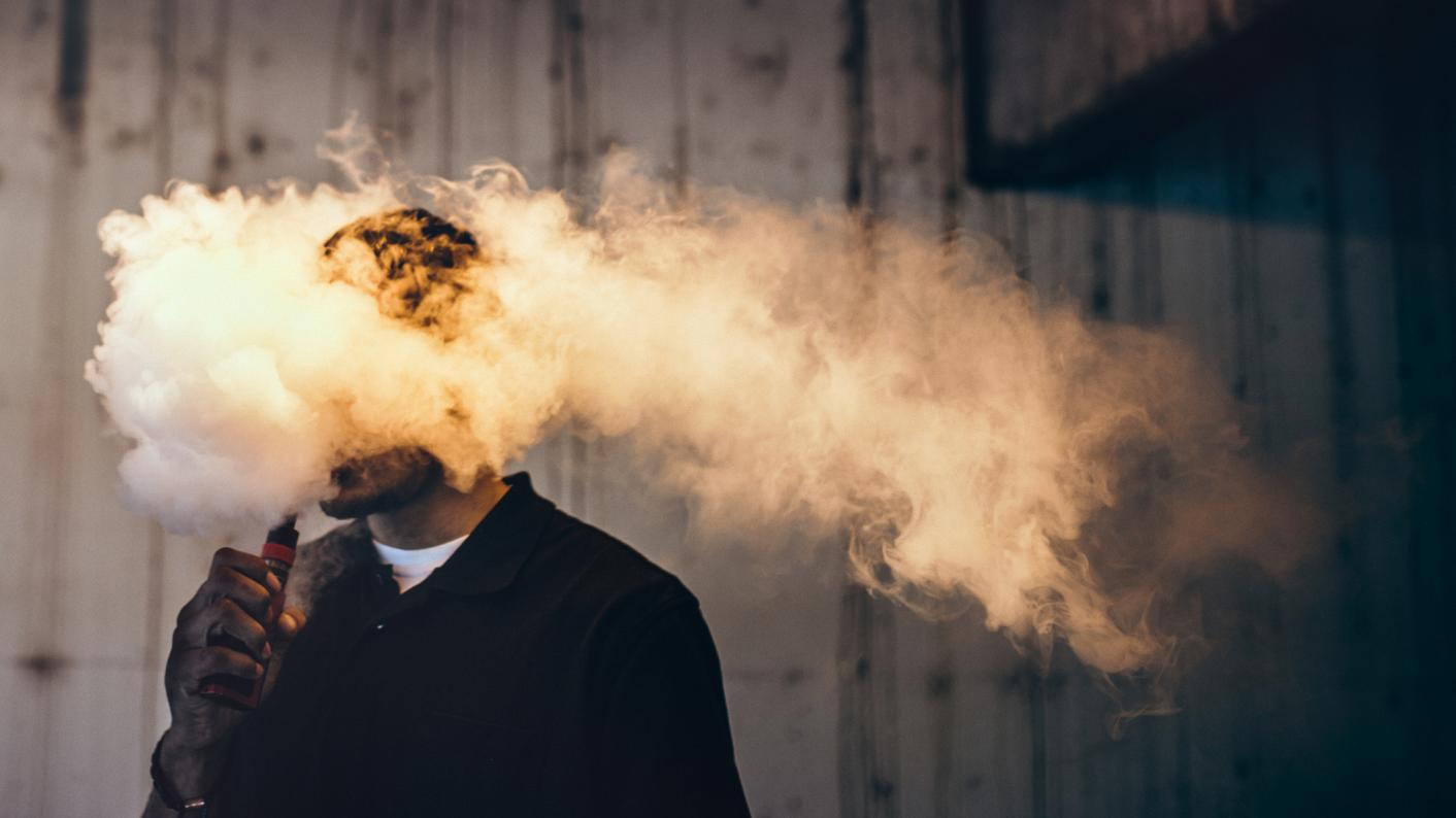 Person covered in a vape cloud