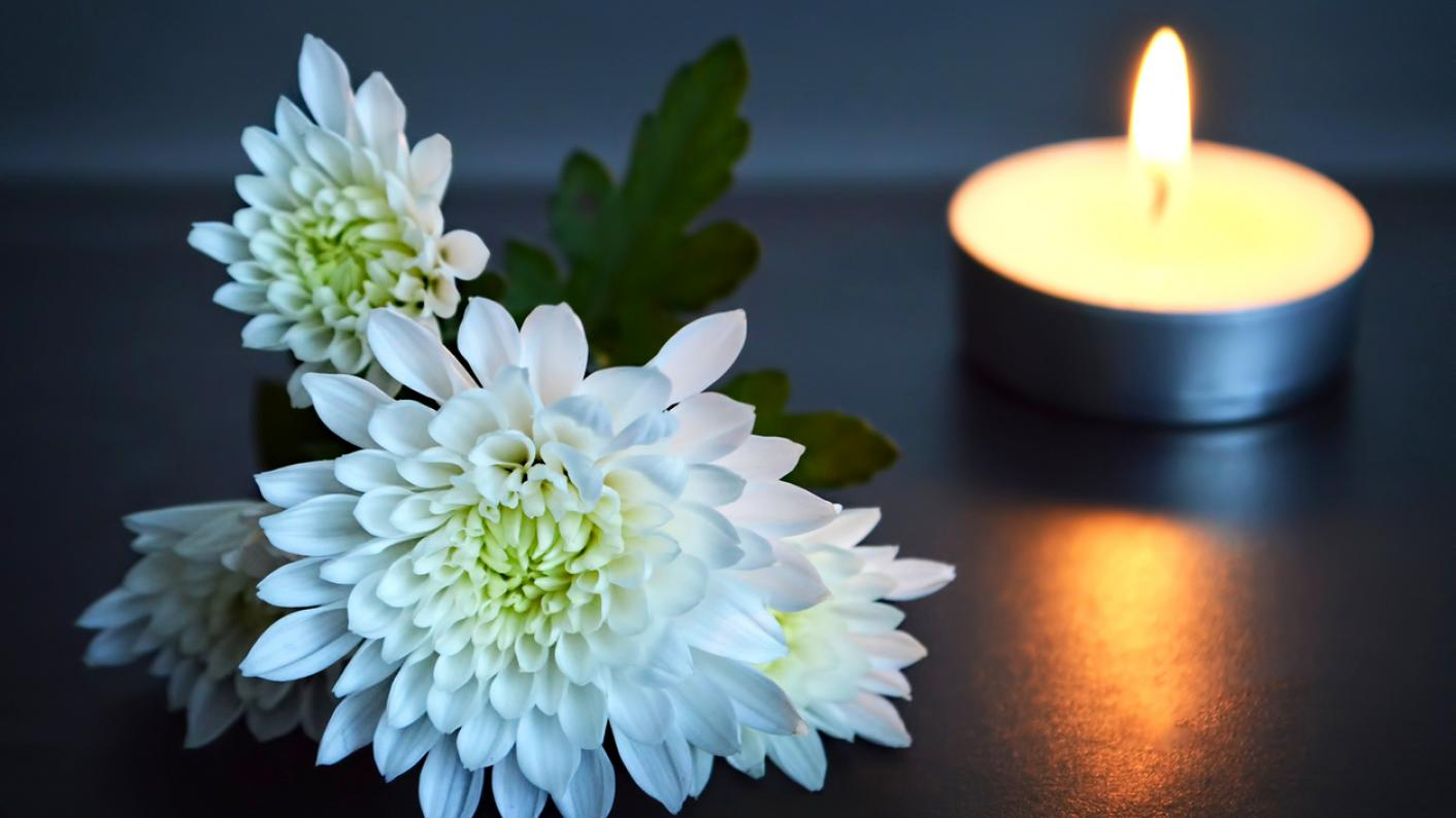 flowers and candle: remembering pupil Leo Latifi, aged 9