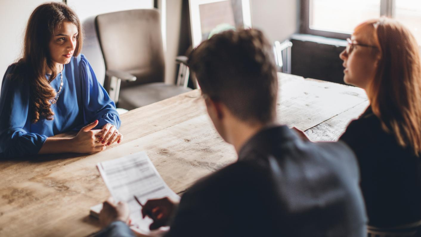 Nervous interviewee faces two people at job interview