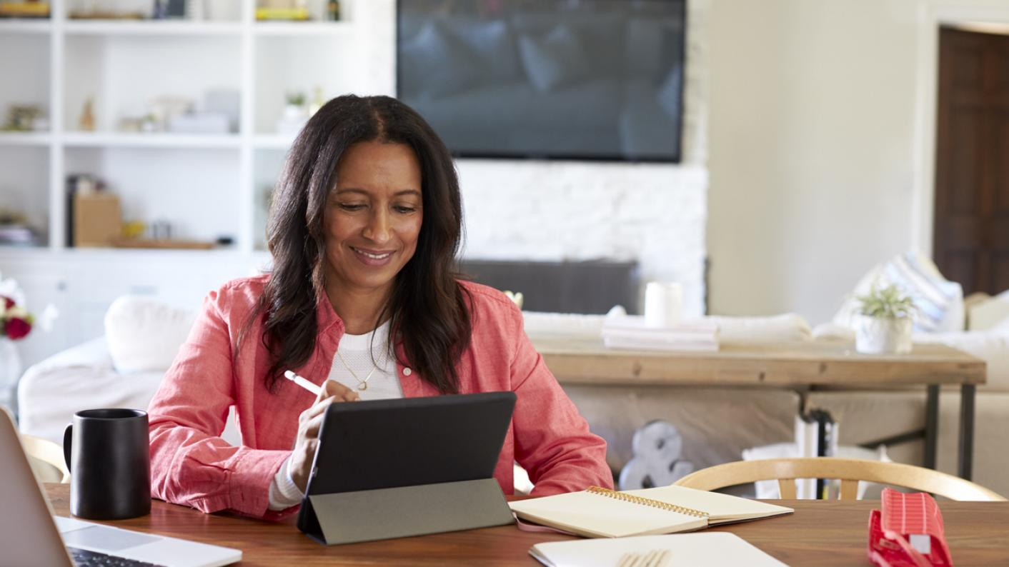 Woman working from home at a laptop