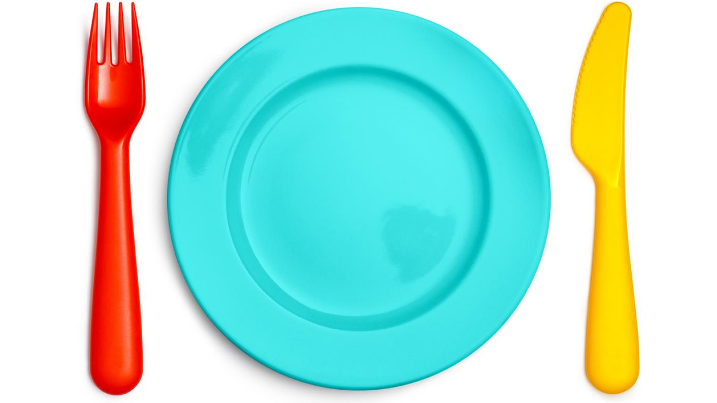 plate with colourful knife and fork