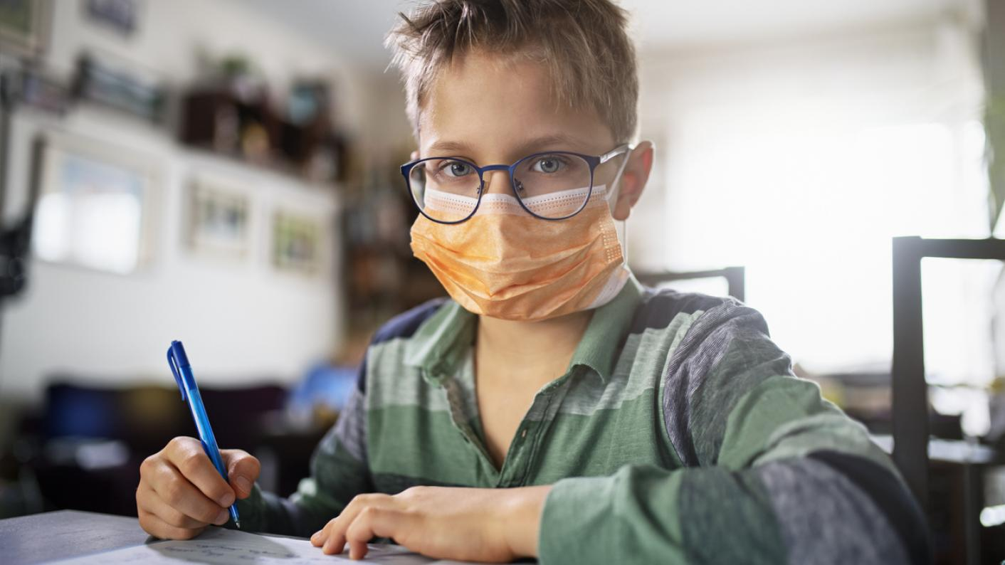 School pupil wearing face mask