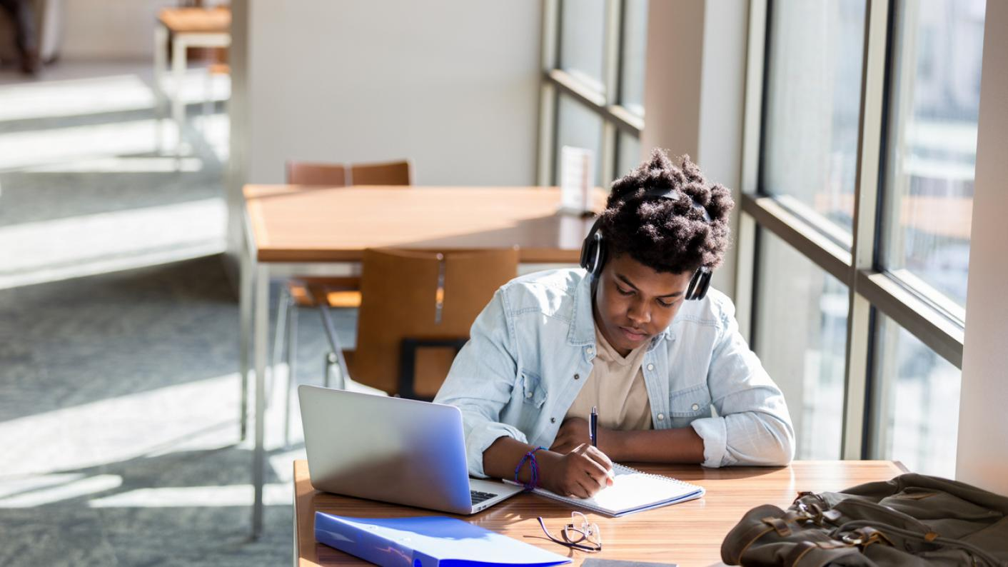 pupil studying in library