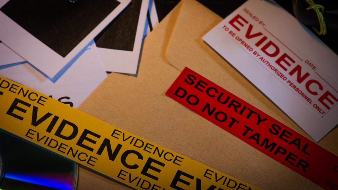 """Police evidence files, and tape labelled """"evidence"""""""