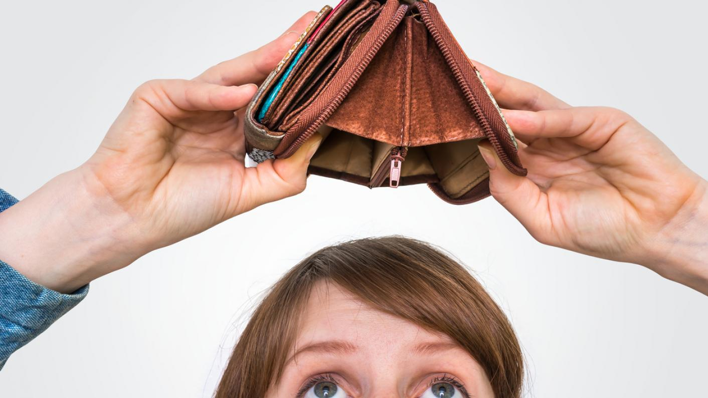 Woman holding empty wallet above her head
