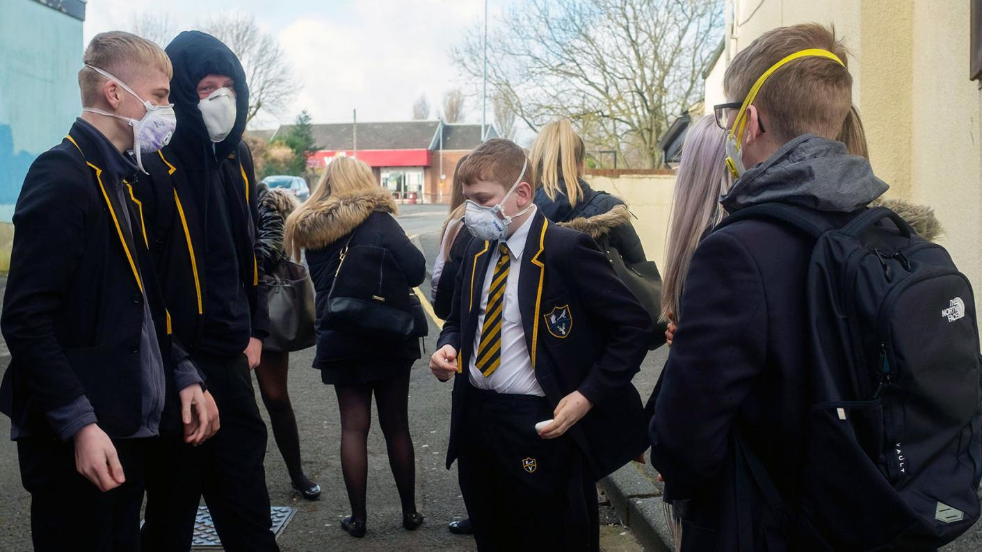 Secondary pupils in a playground, all wearing masks