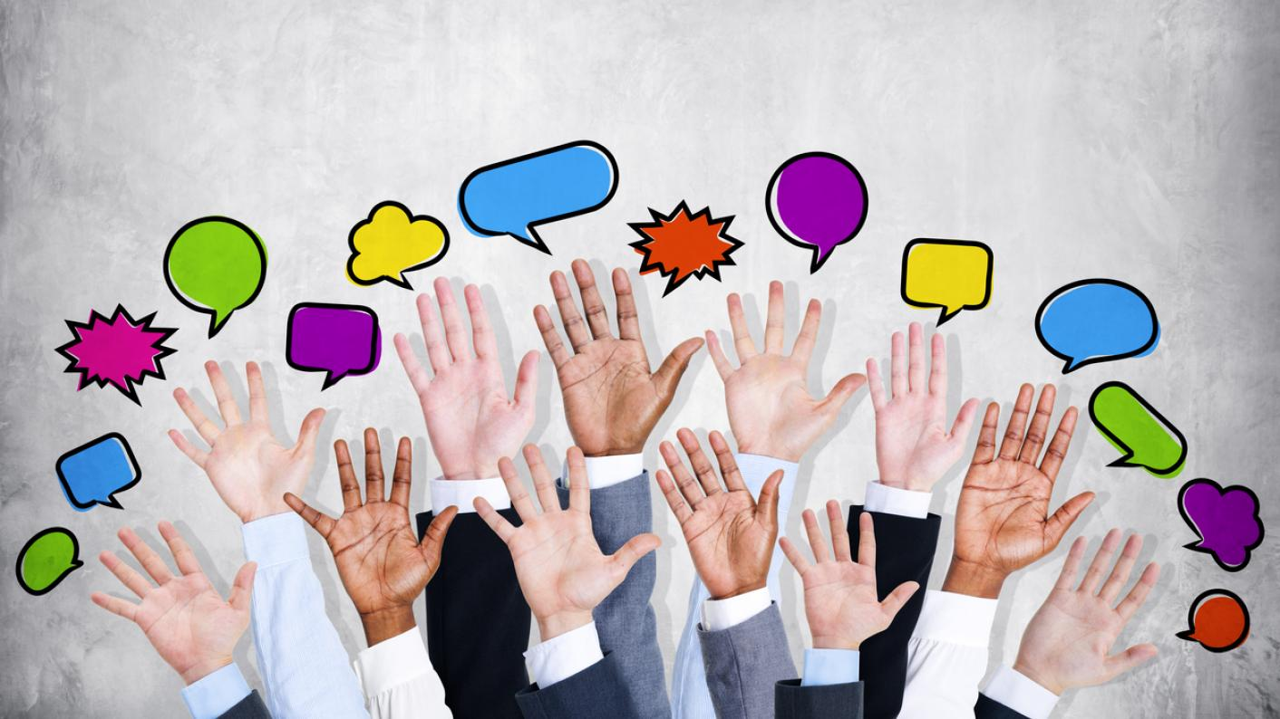 Multiple people's hands raised, with speech bubbles above each of them