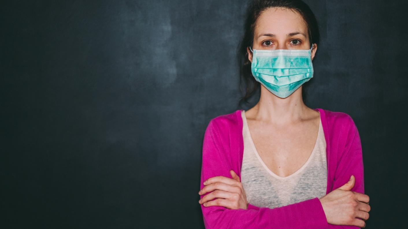 Teacher wearing face mask during Covid-19 crisis