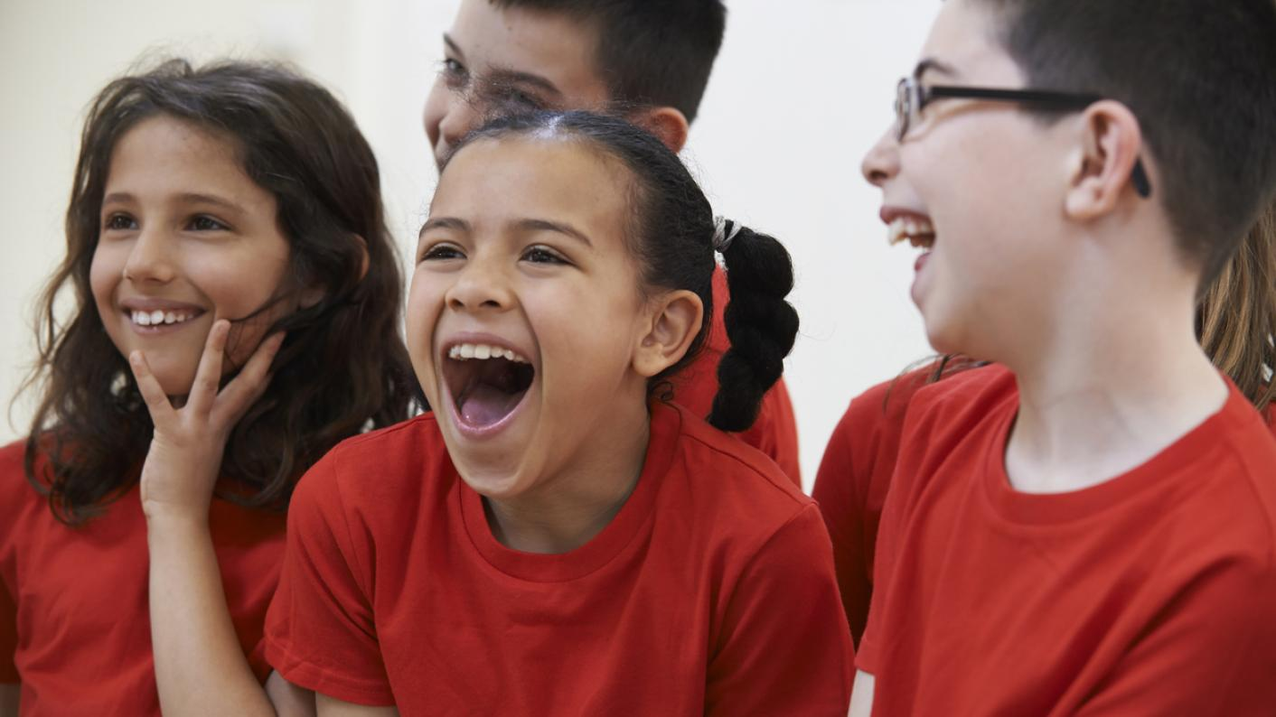 A group of primary-school children, laughing uproariously