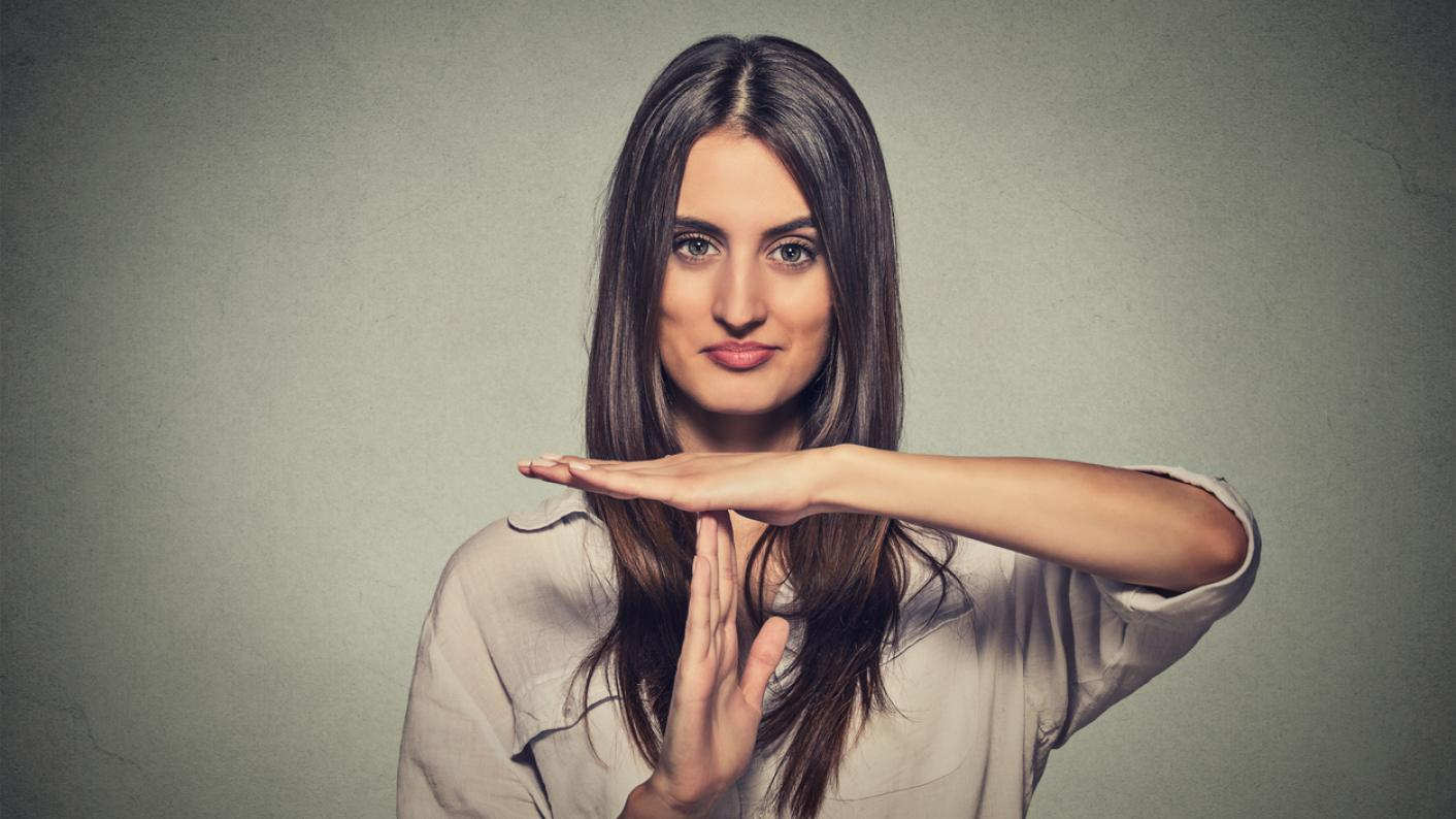 """Woman making """"time out"""" sign with her hands"""