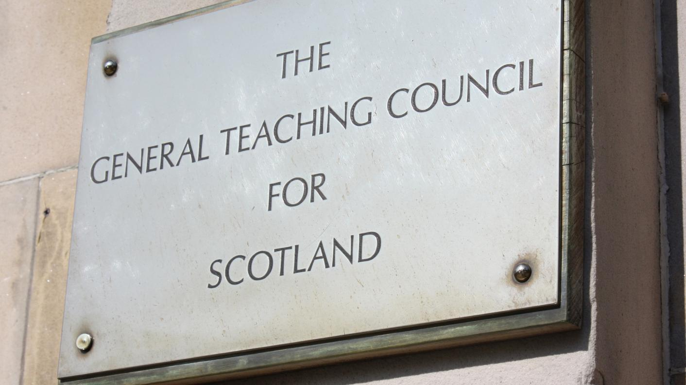A teacher who touched a colleague's breast on a school trip has been banned
