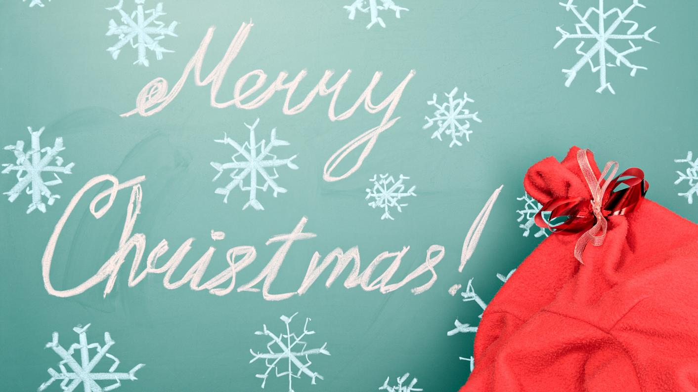Merry Christmas sign with a sack of teaching resources